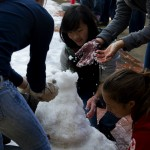 Freshmen work together to build their snowman. Some students brought snow gloves, others had to face the cold snow bare-handed.
