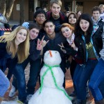 The sophomore snowman builders pose with their respectable-looking snowman. They took second place.