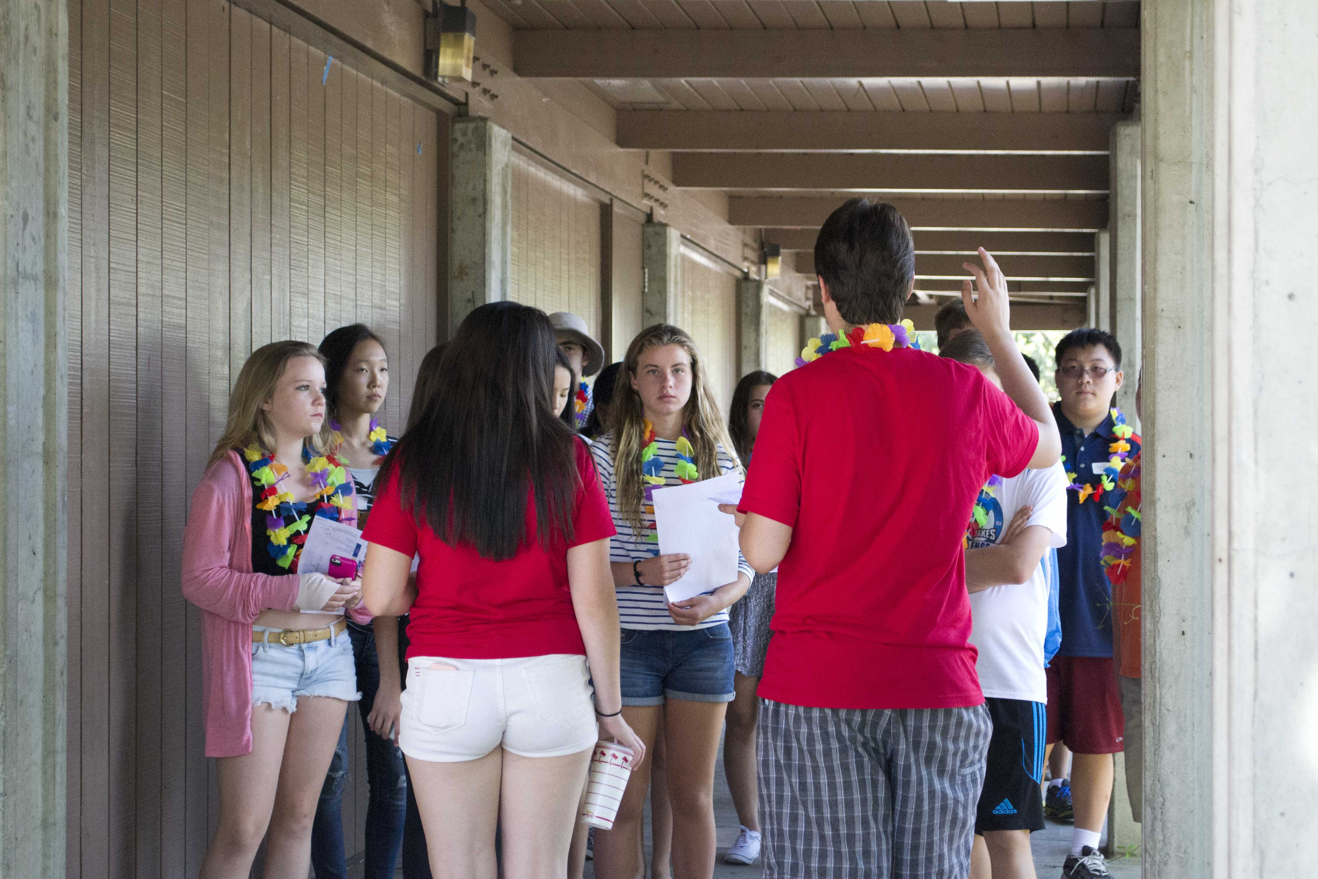 Link Crew Leaders senior Danny Golovinsky and sophomore Sarah Reich guide their group of freshmen through Gunn's campus.