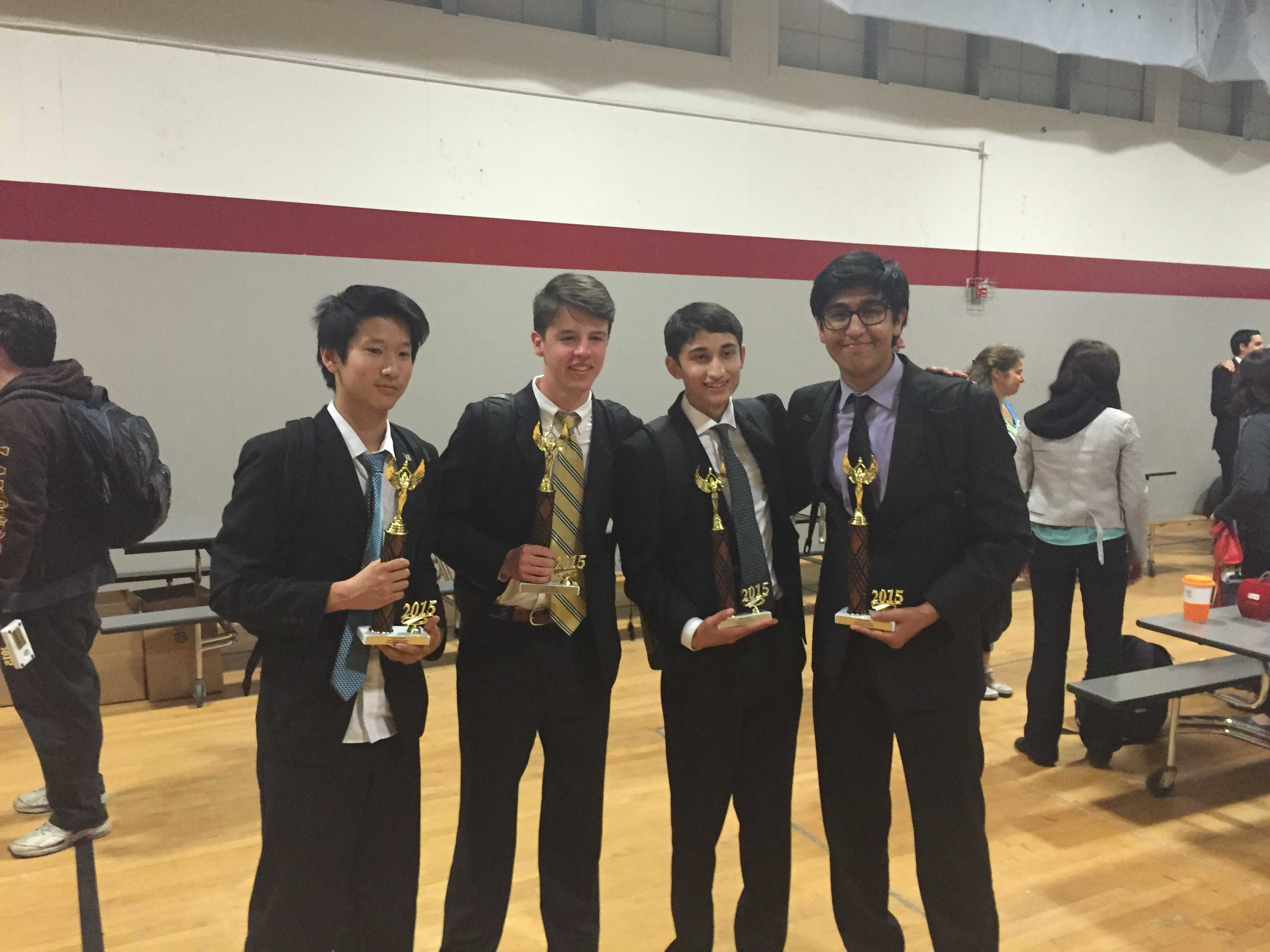 From left to right: Sophomores Andrew Shen and Matthew Hamilton and juniors Kush Dubey and Ajay Raj hold their trophies at Westmont High School after qualifying for the state tournament.