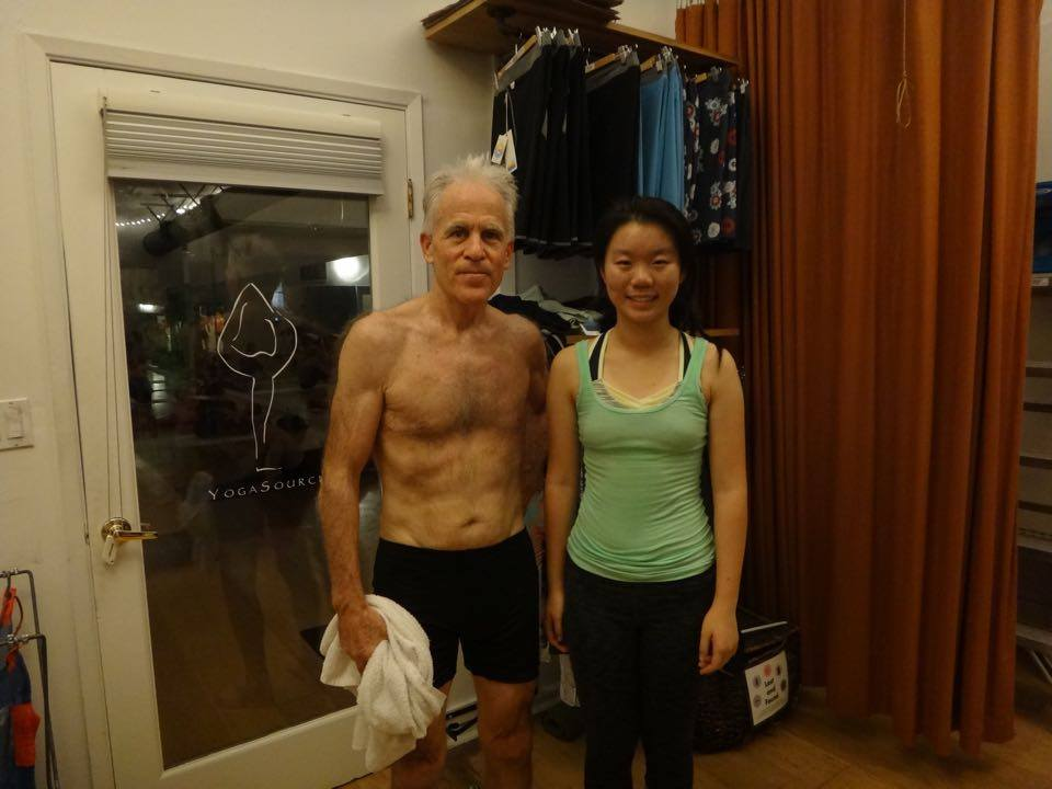 Ding poses with instructor after yoga class. Courtesy of Grace Ding.