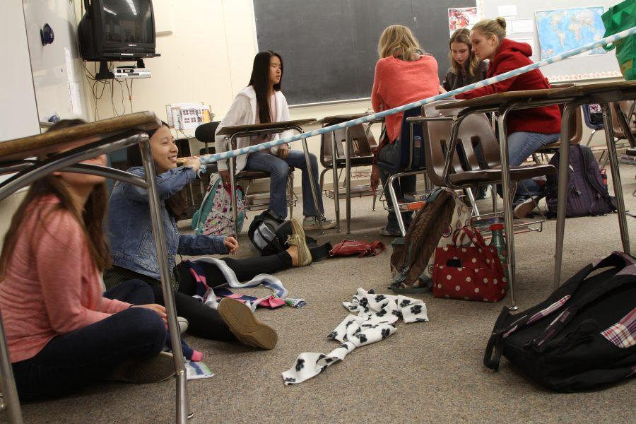 Members of the Toys for Pups club meet on a Monday and help each other make dog toys. Photo by Alexandra Ting.