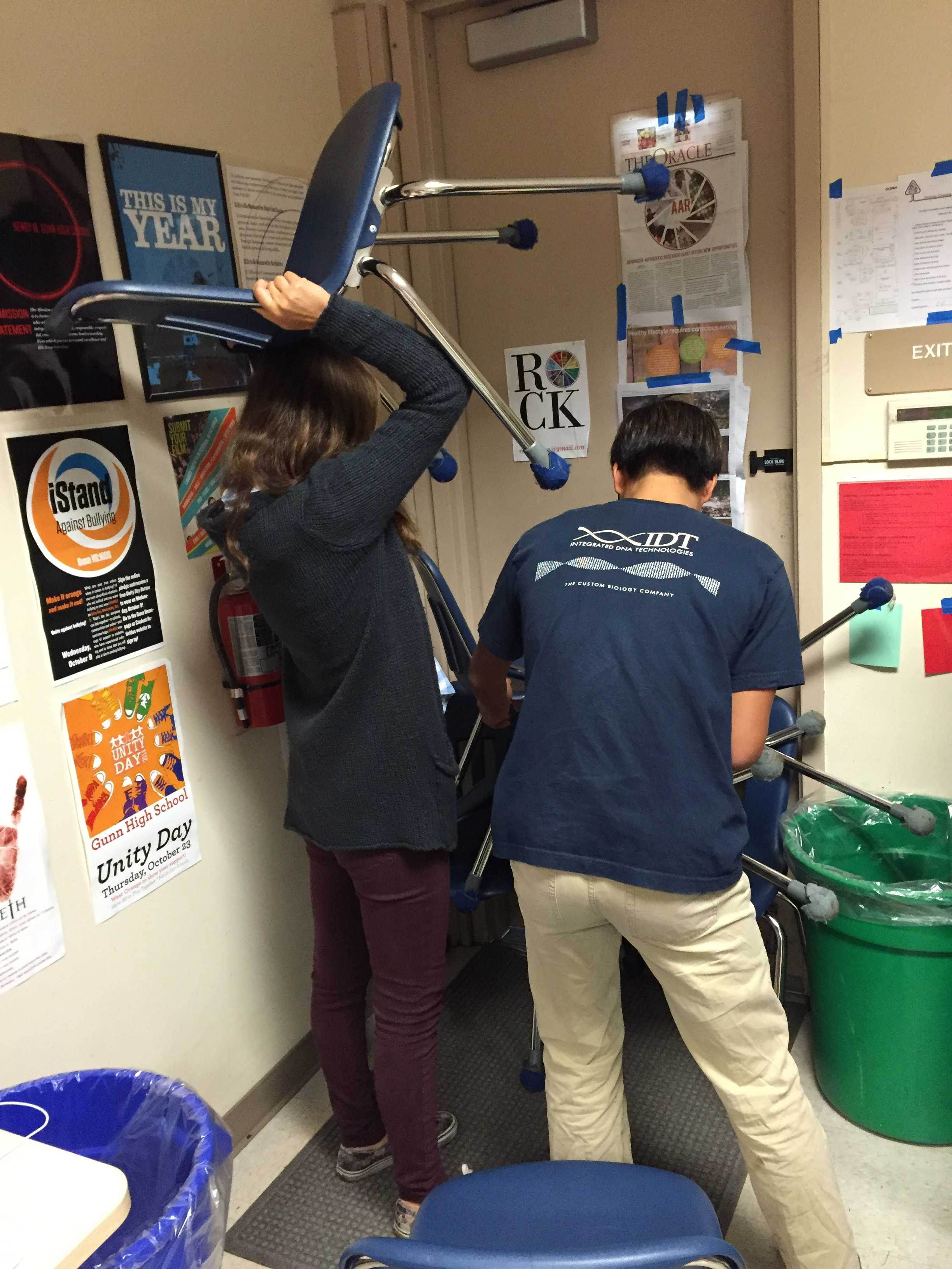 Students in L-6 work together to build an effective barricade with chairs during the Oct. 13 Code Red drill.