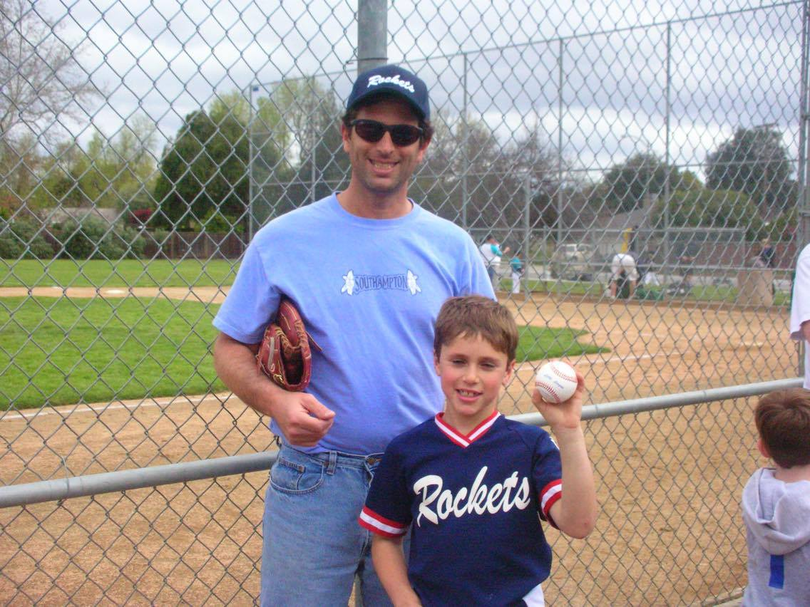 Junior Josh Radin and dad Jon pose at a baseball game in 2006. Courtesy of Josh Radin.