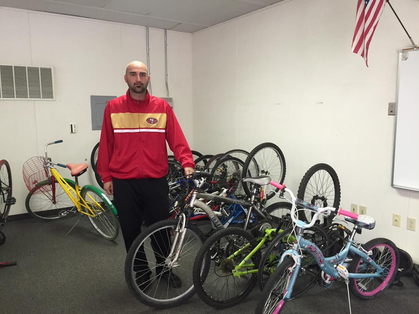 Campus supervisor, Bike Club repair bikes to donate