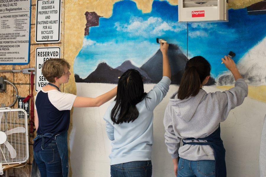 art students paint mural for custodial staff the oracle