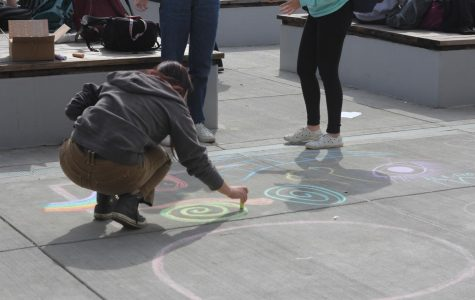 Senior Phebe Cox draws with chalk for a ROCK activity