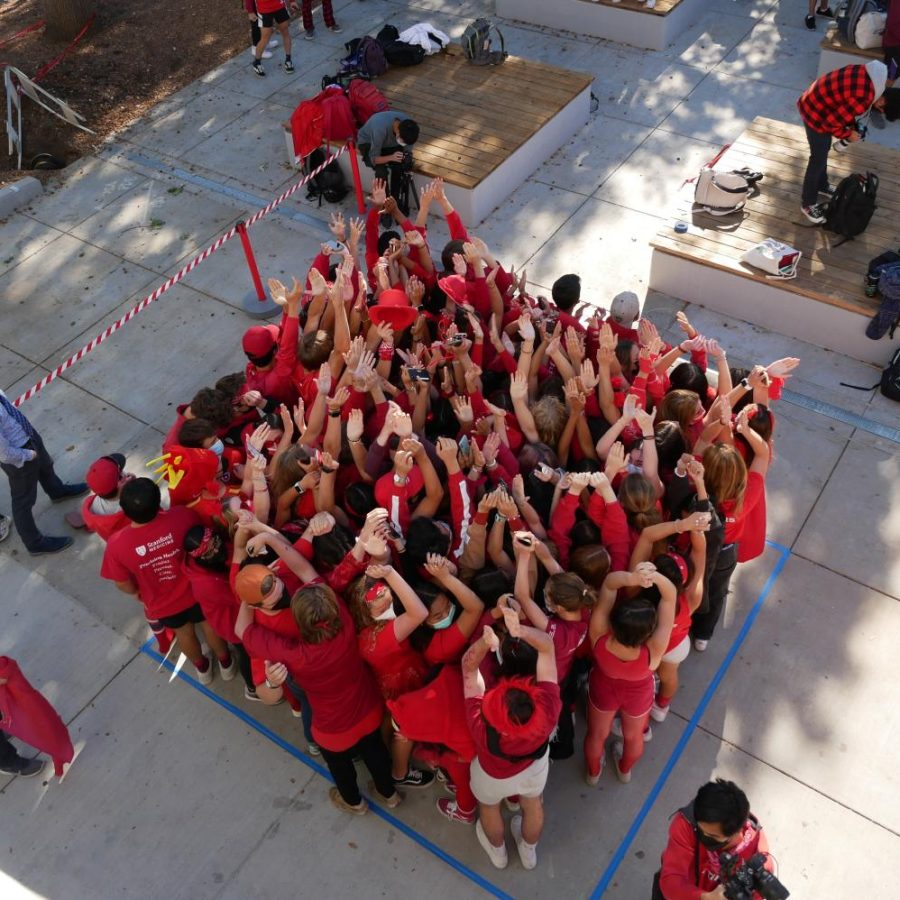 Seniors squeeze close together to fit as many students into the square as possible for Stuff-a-Square, Monday's brunch game.